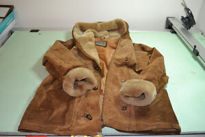 Tan suede winter coat with faux fur lining.