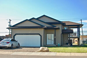 POTENTIAL REVENUE PROPERTY! Newer Duplex FOR SALE in St. Paul AB