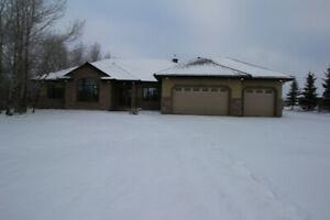 Custom built bungalow with 2.36 acres