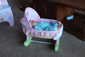 Baby doll and bassinet