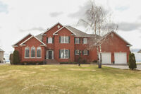 Executive Waterfront Property in Bainsville, Ontario