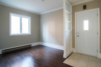 Lower triplex 3 1/2 100% renovated with parking space.