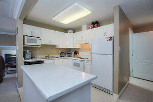 LOVELY 2 BED 2 BATH CORNER UNIT 2 BLOCKS SOUTH OF WHYTE AVE!