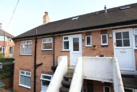2 Bedroom spacious flat private entrance parking and near town centre and beach .