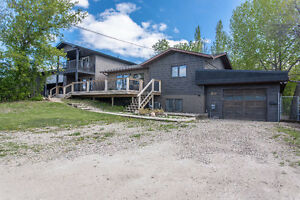 215-217 Sunset Dr., Kinookimaw SK - 3 BDR HOME ON DOUBLE LOT!