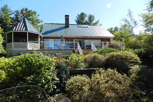 SUNSET BAY YEAR-ROUND GETAWAY! 5 BED WOOD COTTAGE FOR SALE