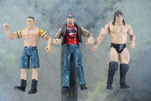 PERSONNAGES DE LUTTE (4  LUTTEURS ) WWE