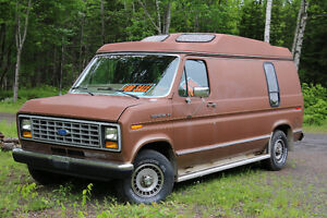 1990 Ford E-150 Van with wheelchair lift.