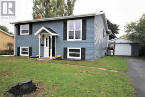 Centrally locates 3 BR 2 Bath house for rent , w/detached garage