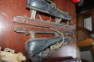 Vintage skates with leather blade guards