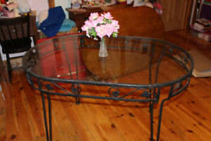 an ornate wrought iron table