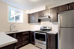 Executive 1 Bdrm+Office Apartment with Garage & In-Suite Laundry