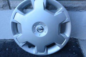 Silver wheel covers; 6-slot with attached chrome NISSAN emblem