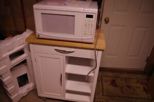 Kenmore microwave oven and cart.