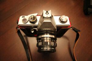 "Camera:  ""Praktica LTL"" Single lens reflex w/2 lenses, flash"