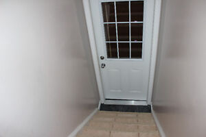 Bright furnished room in basement suite for rent on West side