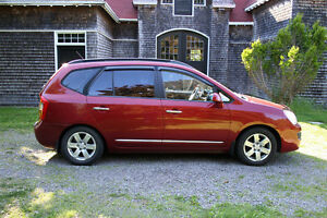 2008 Kia Rondo EX - efficient & reliable wagon + 4 extra wheels.