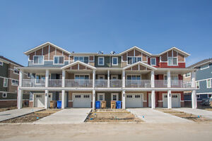 1000+ sq ft townhouse in Harbour Landing with single car garage