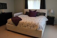 king size white tufted bed