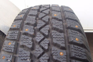 Four studded Arctic Claw tires size P195x65Rx15