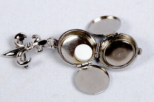 CORO Locket with  TWO hidden storage compartments