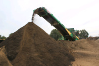Topsoil mixed with manure, skid steer service