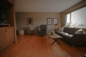 TAUPE COUCH AND RECLINER - VERY GOOD CONDITIOBN