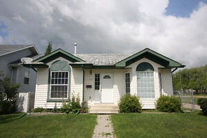 Innisfail Home Bordering Park with Fully Fenced Yard