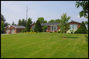 Fabulous country home loaded with curb appeal ON 1.78 OF AN ACRE
