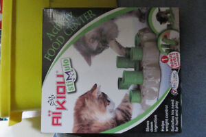 Interactive cat activity food center