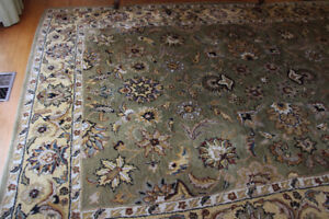 Beautiful 8 X 10 green rug to match any decor