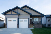 Triple Garage with built in ATV or Sled Storage Springbrook AB
