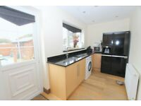 Kitchen with drawers and granite worktop