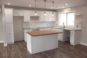 BEAUTIFUL UPDATED 4 BEDROOM HOME IN QUISPAMSIS WITH WATER VIEW!