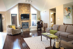 Top shelf custom bungalow with loads of upgrades - a must see!