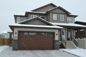 Beautiful Duplex Built in 2016 with Double Heated Garage!
