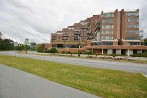 DOWNTOWN DARTMOUTH CONDO WITH POOL AND WATER VIEW FROM BUILDING