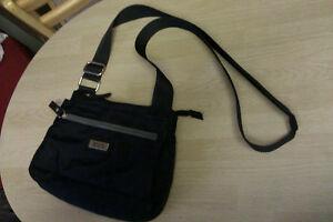 Roots purse (black) has an adjustable shoulder strap