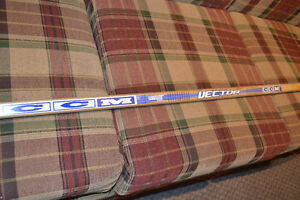2 wooden hockey sticks