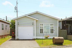 Mobile Home Located in Sought after East End with a GARAGE !!