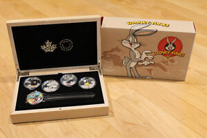 SIlver 1oz Looney Toons 4-coin Set with Wrist Watch! $450 Retail