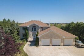 Beautiful 2.91 acre treed property with spacious 4 bedroom home in West St Paul, Manitoba, Canada