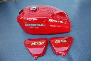 Honda CB400F fuel tank and side covers flawless ruby red