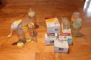 Tire lait, biberons, mouche bébé, verre à et petites cuillères .