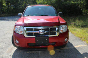 Ford Escape XLT with 128,000km   $6500