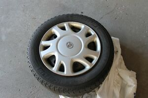 4 winter tires on rims, and hub caps Cambridge Kitchener Area image 1