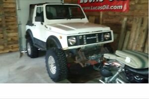 2 suzuki samurais an another with no axles  projects for trade