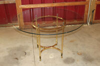 Brass dining table with glass top