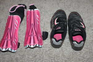 Girl's soccer cleats, size 2 and shinguards - $8