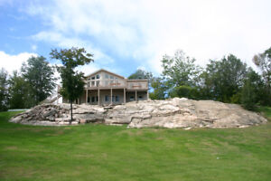 5 bedroom , 3,000 sq fr cottage on lakefront 2 full washrooms